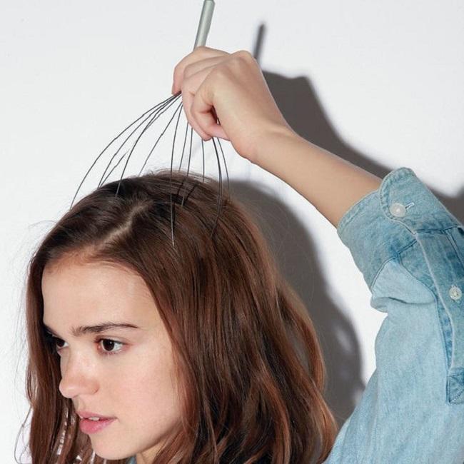 Aparato de aluminio para rascarse la cabeza